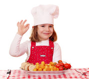 Little girl cook with ok sign and gourmet food Stock Photos