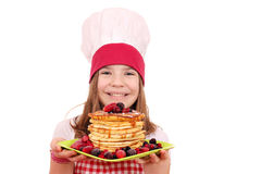 Little girl cook with pancakes Stock Photos