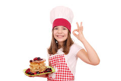 Little girl cook with pancakes and ok hand sign Royalty Free Stock Image