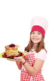 Little girl cook with pancakes on plate Royalty Free Stock Image