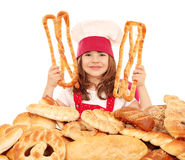 Little girl cook with pastry and breads Royalty Free Stock Photos