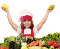 Little girl cook with peppers Royalty Free Stock Photo