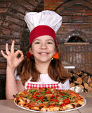 Little girl cook with pizza and ok hand sign Royalty Free Stock Image