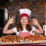 Little girl cook with pizza and ok hand sing Royalty Free Stock Images