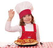 Little girl cook with pizza and ok sign Stock Images
