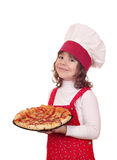 Little girl cook with pizza on plate Stock Photos