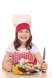 Little girl cook with prepared fish ready for lunch Royalty Free Stock Photo