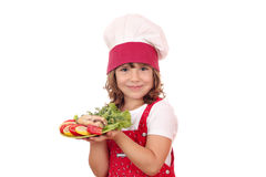 Little girl cook with prepared salmon Royalty Free Stock Photos