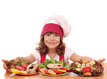 Little girl cook with prepared salmon seafood Stock Photography