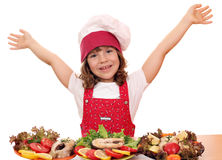 Little girl cook with prepared salmon seafood Royalty Free Stock Images