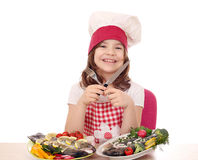 Little girl cook with prepared trout ready for lunch Stock Images