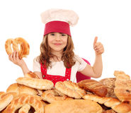 Little girl cook with pretzel and thumb up Stock Image