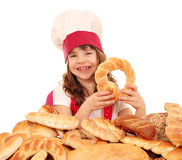 Little girl cook with pretzels bread and buns Royalty Free Stock Photography