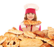 Little girl cook with pretzels and bread Stock Images