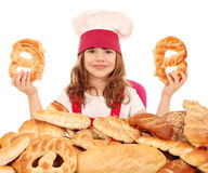 Little girl cook with pretzels Royalty Free Stock Image