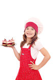 Little girl cook with raspberry cake Royalty Free Stock Photography