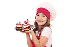 Little girl cook with raspberry cake Stock Image