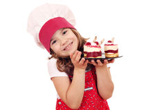 Little girl cook with raspberry cake Royalty Free Stock Images