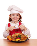 Little girl cook with roasted chicken Royalty Free Stock Photos