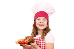 Little girl cook with roasted chicken wings franch fries a Royalty Free Stock Image