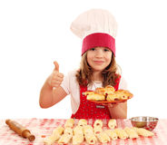Little girl cook with rolls and thumb up Stock Images