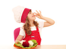 Little girl cook with salad and ok hand sign Stock Photography