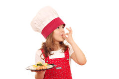 Little girl cook with salmon Stock Photos