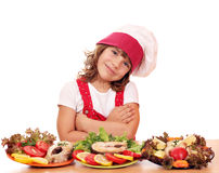 Little girl cook with salmon sea food Stock Images