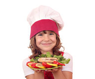 Little girl cook with salmon seafood Royalty Free Stock Photo