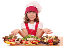 Little girl cook with salmon seafood Stock Photo