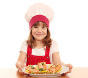 Little girl cook with salmon seafood Stock Images