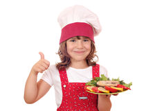 Little girl cook with salmon Stock Image