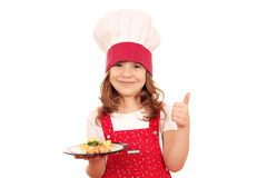 Little girl cook with salmon and thumb up Royalty Free Stock Images