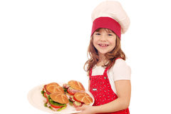 Little girl cook with sandwiches Royalty Free Stock Images