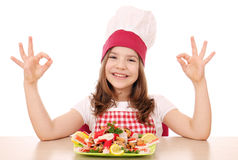 Little girl cook with seafood and ok hand signs Stock Image