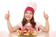 Little girl cook with seafood and thumbs up Stock Photography
