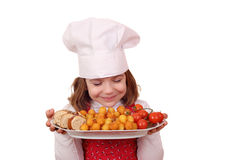 Little girl cook smell food Royalty Free Stock Photos