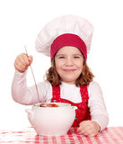 Little girl cook with soup Royalty Free Stock Photos