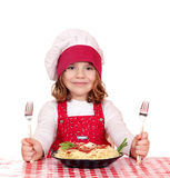 Little girl cook with spaghetti for lunch Stock Images
