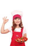 Little girl cook with spaghetti and ok hand sign Stock Photography
