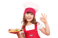 Little girl cook with spaghetti and ok hand sign Royalty Free Stock Photos