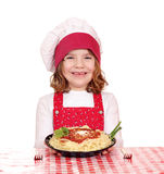Little girl cook with spaghetti on table Royalty Free Stock Photos