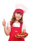 Little girl cook with spaghetti and thumb up Stock Photography