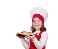 Little girl cook with spaghetti on white Stock Images
