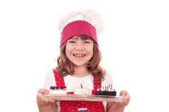 Little girl cook with sweet cakes Stock Photo
