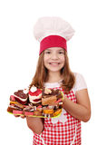 Little girl cook with sweet cakes Royalty Free Stock Images