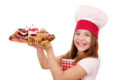 Little girl cook with sweet cakes Stock Image