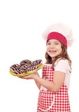 Little girl cook with sweet chocolate donuts Royalty Free Stock Photo