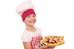 Little girl cook with sweet crepes Stock Photography