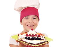 Little girl cook with sweet crepes on plate Royalty Free Stock Photos